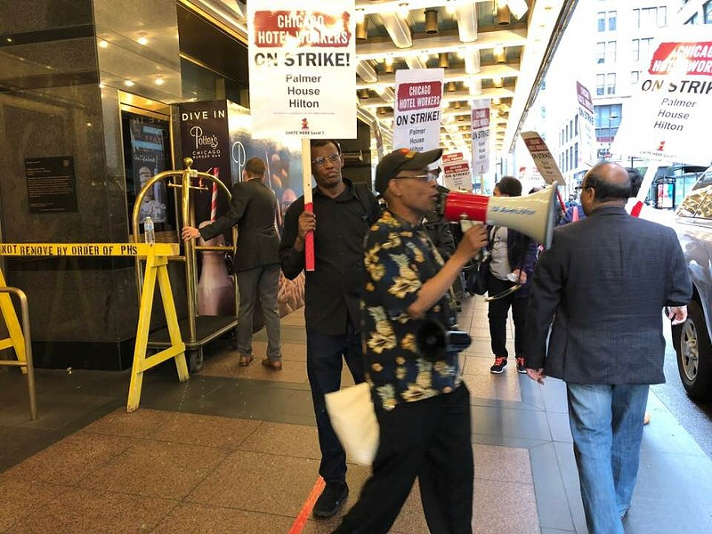 Picketers in front of the Palmer House Hilton. The strike started on September 7. - BRITA HUNEGS