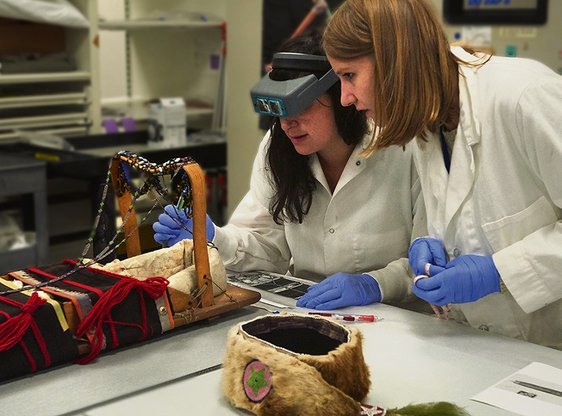 Assistant conservators Nicole Passerotti and Erin Murphy test for harmful chemicals that may be present due to old collection practices. - JOHN WEINSTEIN