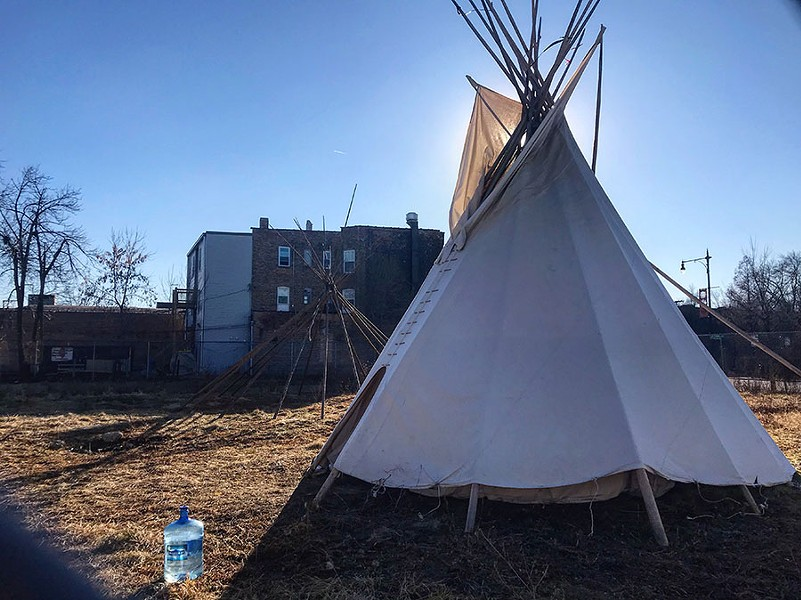 Native American Chicagoans gather in the tipi to play traditional hand and stick games and host storytellers around a fire. - NATALYA CARRICO
