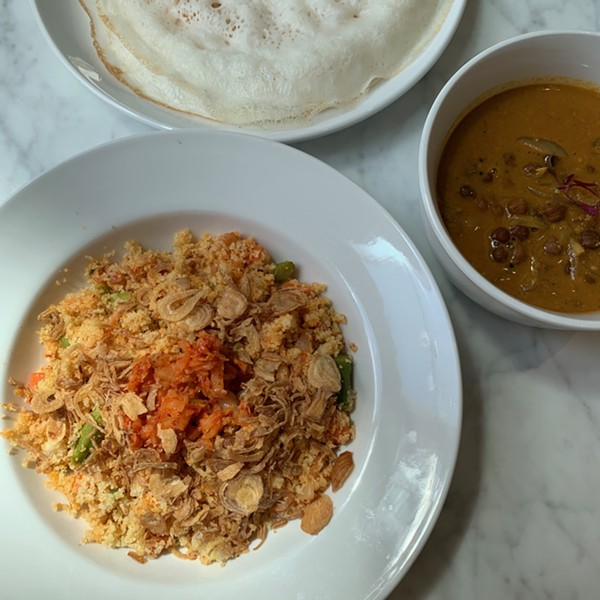(counterclockwise from bottom) Kimchi upma, kadala curry, and appam, crepes made with fermented rice flour and coconut milk - MIKE SULA