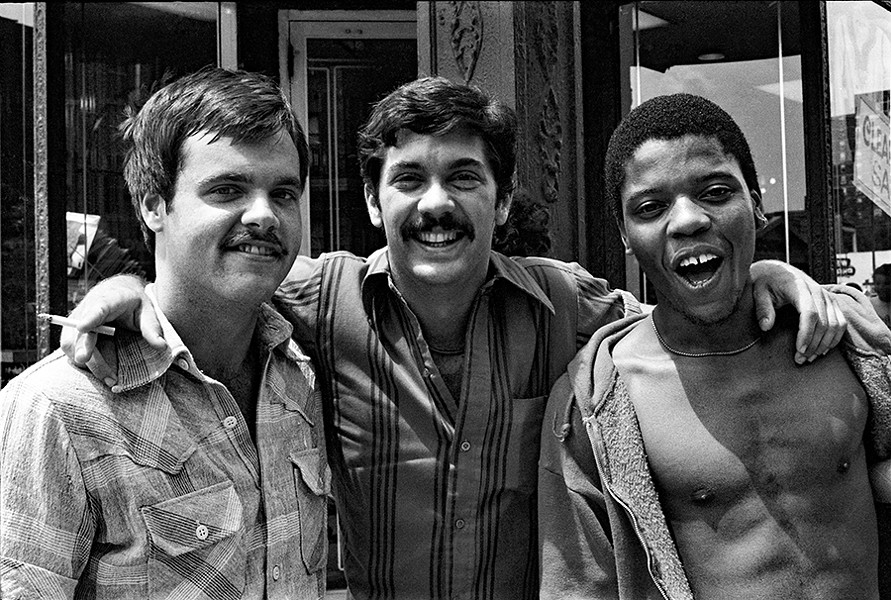 Three good friends enjoying the parade on North Broadway. The young man on the right is Ray Ray Thomas. - DIANE ALEXANDER WHITE