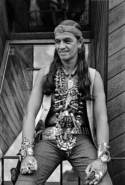 Man wearing a collection of Zuni, Hopi, and Navajo jewelry, including an eagle talon and bear claws - DIANE ALEXANDER WHITE