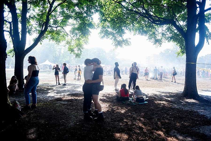 July 21, 2019: Emily Wolniewicz, 21, and Avian Ciganko-Ford, 21, both of Minnesota, take a break under the trees while attending the Pitchfork Music Festival in Union Park. - KATHLEEN HINKEL