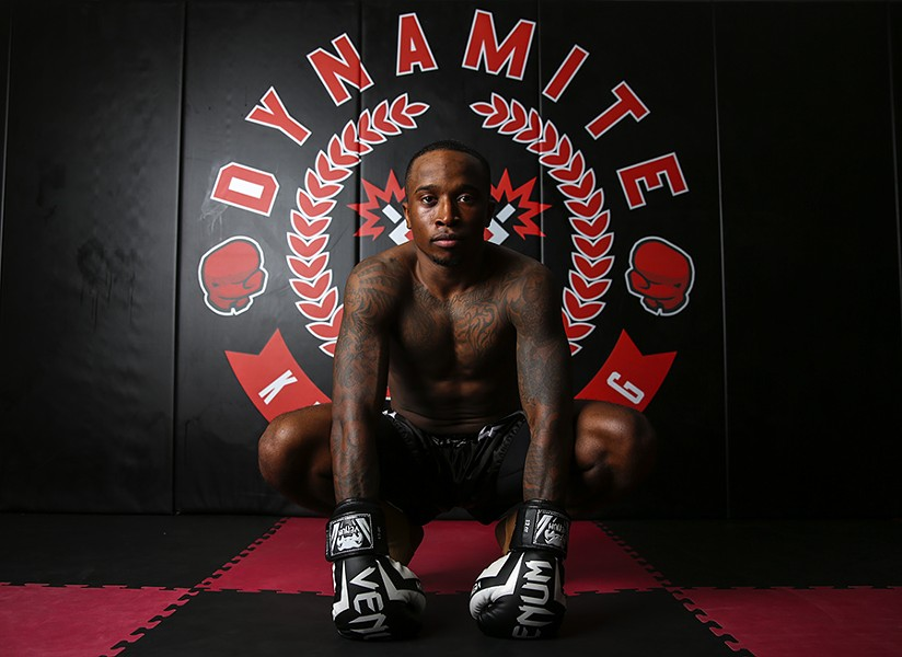 "Derek Jackson, 26, Dynamite Kickboxing - ""It's an individual sport, and it's always me in there, but I take all these guys with me when I'm in the ring. All the training we go through together, the time that they take out of the day to help individual students and to help each other. You're going to have time when you face adversity, and when you have guys like them, your teammates, your coaches backing you up, it just makes your life a lot easier and taste a lot sweeter when you get that victory. It feels like a family. They always pick me up in training and life."" - GEOFF STELLFOX"