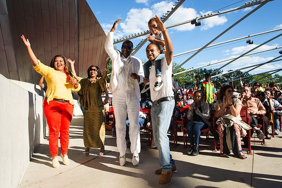 Ethiopian singer Mahmoud Ahmed (in white) performs at Pritzker Pavilion during the 2015 World Music Festival. - PATRICK L. PYSZKA