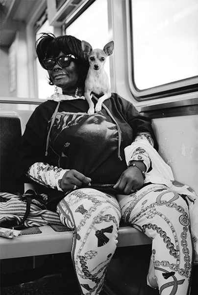 """Lady T with her dog Shorty. """"When I pop out, Shorty pop out."""" - W.D. FLOYD FOR CHICAGO READER"""