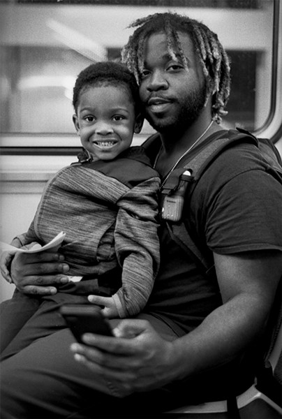 Maurice Mitchell, with son Makai, approaches Garfield. - W.D. FLOYD FOR CHICAGO READER