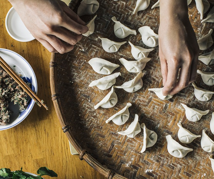 Brenda Siharath prepares dumplings filled with pork and dill. - JEFF MARINI FOR CHICAGO READER