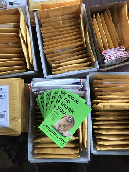 Women and Children First orders going out to customers. - SARAH HOLLENBECK