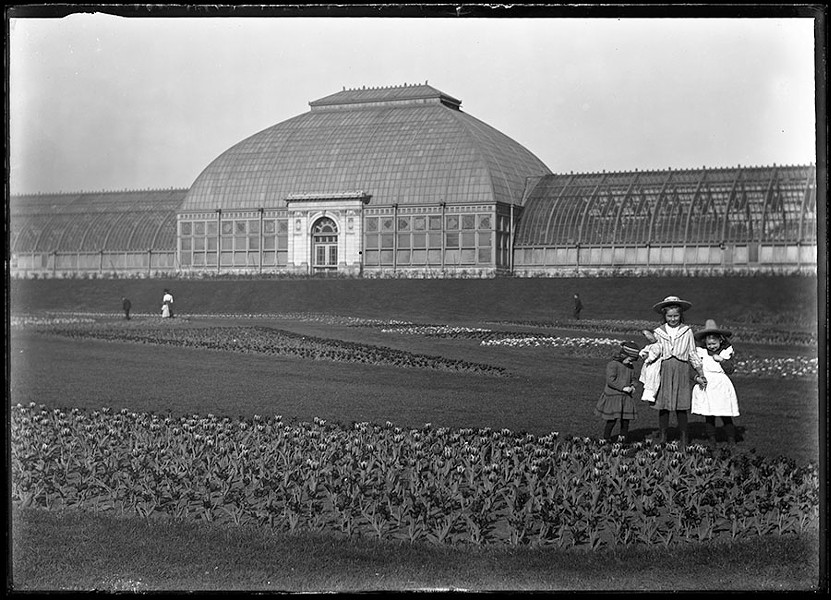 Girls pose among the tulip beds at Washington Park Conservatory. - RUDOLPH F. MICHAELIS / COURTESY NEWBERRY LIBRARY