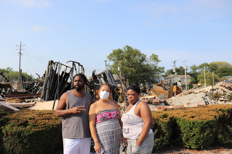 Trurun Clary stands in front of rubble of the former Department of Corrections building with Tre Daniels (middle) and Brittany Collins (right) on Tuesday, August 25,2020. - ADAM MAHONEY / INJUSTICE WATCH