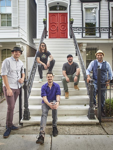 The lineup of the Red Door Band shifts constantly, but on September 5 it was Danny Bauer (purple shirt) and Jack Macklin (far left), the two core members, plus Tim Seisser (sunglasses), Zack Marks (green pants), and Victor Garcia (blue vest). - MATTHEW GILSON FOR CHICAGO READER