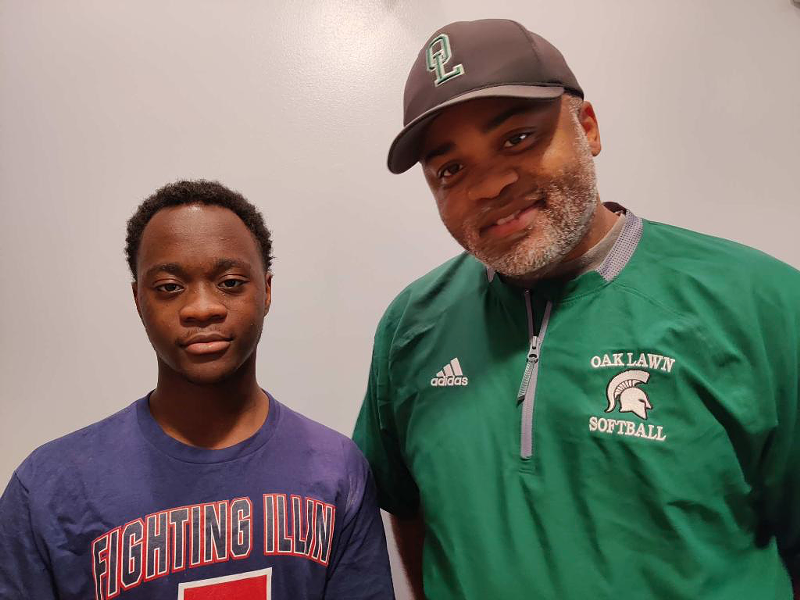 Oak Lawn High School football coach Harold Blackmon (right) teaches his son Jai'el Blackmon about what it's like to be a Black man in America. - HAROLD BLACKMON