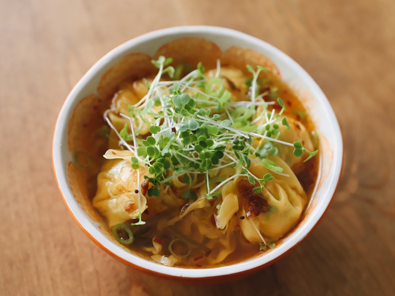Shrimp and leek wontons, fat egg noodles, and micro greens with scallion chili oil in chicken broth - COURTESY DARLENE PHAN