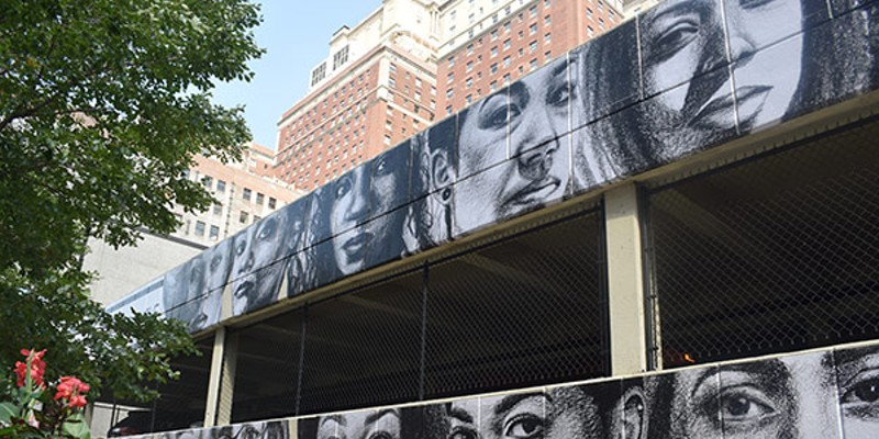 The mural peers out over the corner of Eighth and Wabash.