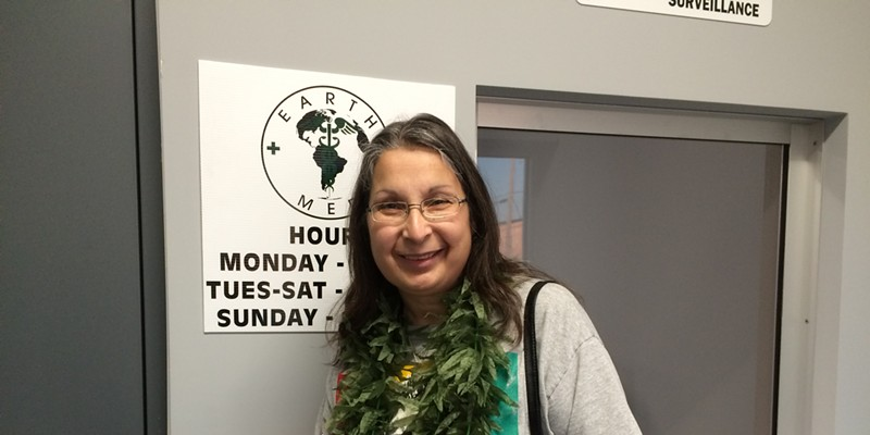 On Tuesday, Michelle DiGiacomo donned a marijuana lei as she made her first legal medical pot purchase at EarthMed in Addison, one of eight dispensaries that opened for business this week in Illinois.