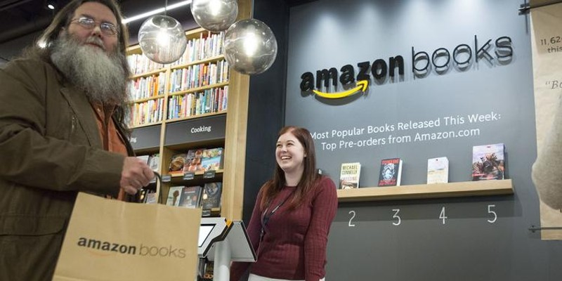 Customers shop at the Amazon Books store in Seattle—also coming soon to Lakeview.