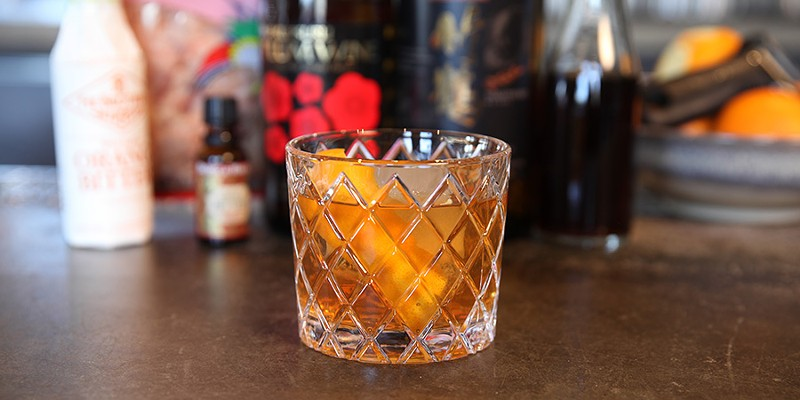 Watch a BellyQ bartender make a newfangled old-fashioned using dancing fish flakes