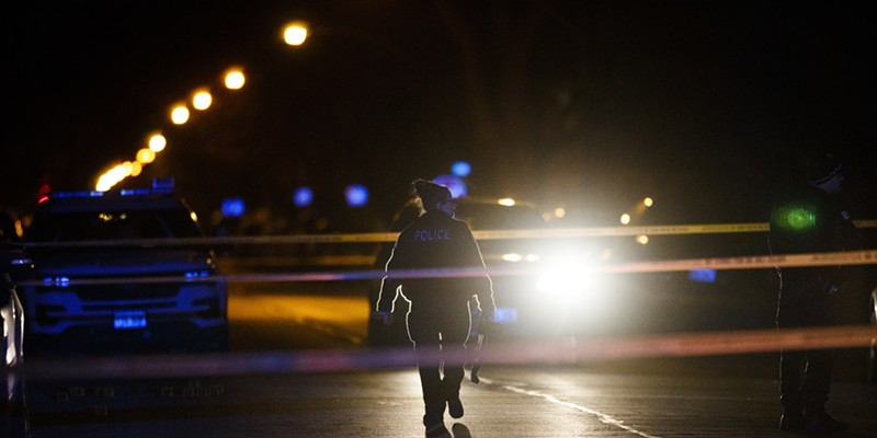 Police work the scene where a 11-year-old was shot in January.