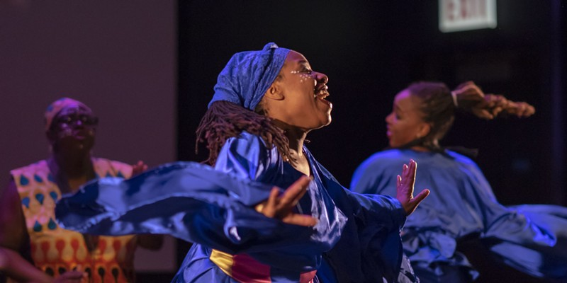 Members of Ayodele Drum & Dance perform at the opening of the Green Line Performing Arts Center on Saturday