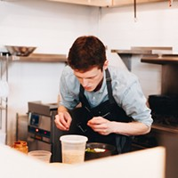 Kitsune Justin Behlke putting the finishing touches on a bowl of ramen Jiayue Yu