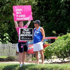 Opposing sides at a rally outside Planned Parenthood in Missouri