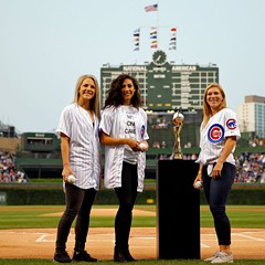 The Red Stars' Julie Johnston, Christen Press, and Lori Chalupny pose with the Womens' World Cup at Wrigley in August
