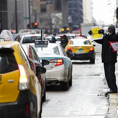 Chicago taxi drivers demonstrated outside City Hall and circled neighboring streets to protest the granting of a city license to rideshare company Uber in February.