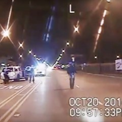 A frame from the dash-cam video of the fatal shooting of  Laquan McDonald. The 17-year-old, carrying a knife,  walks down Pulaski Road as officers Jason Van Dyke and Joseph Walsh train their guns on him. Moments later, Van Dyke, the officer on the right in this frame, opened fire on McDonald.