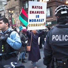 Protesters calling for Rahm Emanuel's resignation marched down State Street December 6.