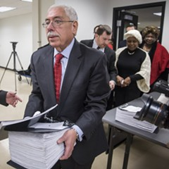 Cook County assessor Joseph Berrios carries nominating petitions for the Democratic slate of candidates.
