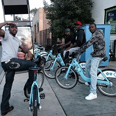 Friends check out Divvy bikes in East Garfield Park on one of three days in September when day passes were free.