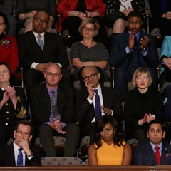 The empty seat next to the first lady was a symbolic seat for victims of gun violence. So why did the president all but ignore that issue in his speech?