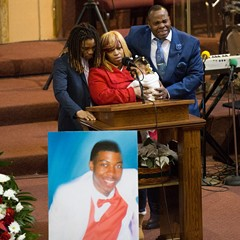 Antonio LeGrier, right, is overcome with emotion during his son Quintonio's January 9 funeral.