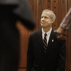 Governor Bruce Rauner waits to be announced before delivering his State of the State address.