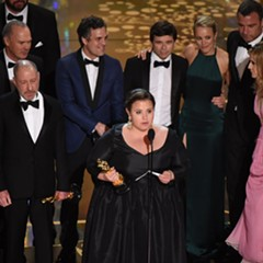 The production team and cast members of Spotlight accept the award for Best Picture.