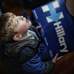 A young Hillary Clinton supporter watches Hillary's victory speech during Primary Day Tuesday night.