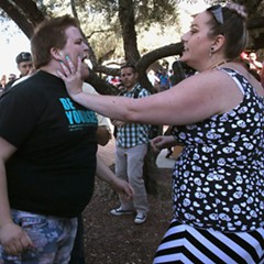 A protester and supporter get into an altercation at a Trump rally in Tucson Saturday.