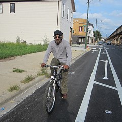 Housepainter James Woods rides in the Lake Street protected bike lane on the west side in September 2014.