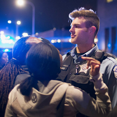 Demonstrators protesting the shooting death of 16-year-old Pierre Loury confront police during a march on April 12, 2016.