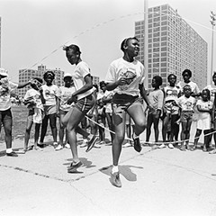 Two girls play double Dutch outside the Cabrini-Green housing development in July of 1984.