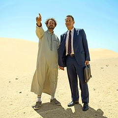 Tom Hanks (right) as salesman Alan Clay and Alexander Black as his driver, Yousef