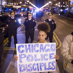 Demonstrators march through downtown on December 11, 2015.