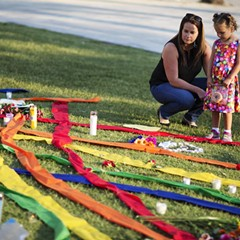 Rhonda Rodeffer visits a makeshift memorial in Orlando with her four-year-old daughter, Kennedy.