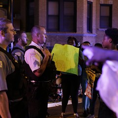 Demonstrators confronted police officers Friday as they protested the fatal police shooting of Paul O'Neal last month.