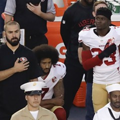 San Francisco 49ers quarterback Colin Kaepernick, middle, kneels during the national anthem at a preseason game Thursday.