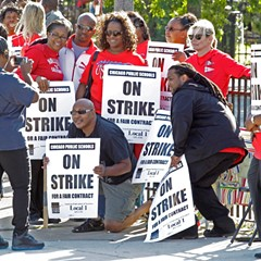 Chicago Public Schools teachers take a group picture as they walk a picket line in 2012.