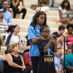 Eleven-year-old J'dyn Simmons, right, talks about his fear of police during a public forum hosted by the U.S. Department of Justice at Truman College in July.