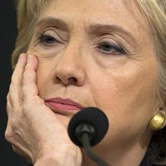 Former Secretary of State Hillary Clinton listens while testifying before the House Benghazi Committee in October 2015.