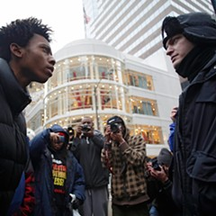 Activist Lamon Reccord, left, stares down a police officer during a black Friday protest along the Michigan Avenue in November 2015.